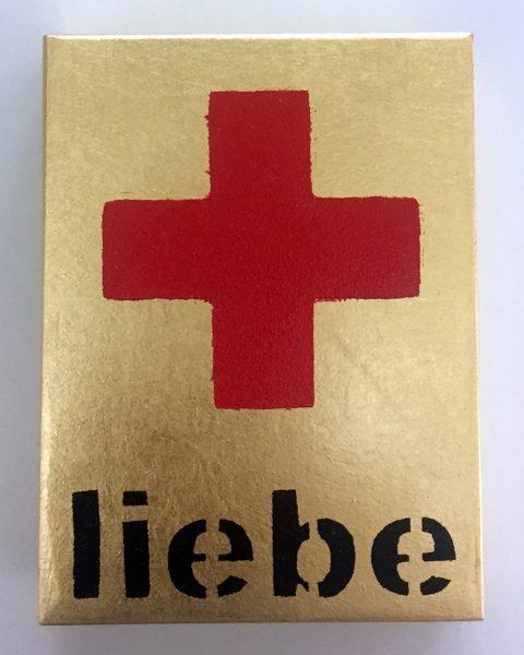 Bild eines Erste-Hilfe-Kastens mit rotem Kreuz und Aufschrift