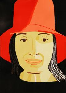 Gesicht einer Frau mit rotem Hut