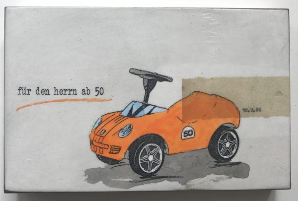 Popart-Bild eines orangenen Bobbycars mit der Schrift